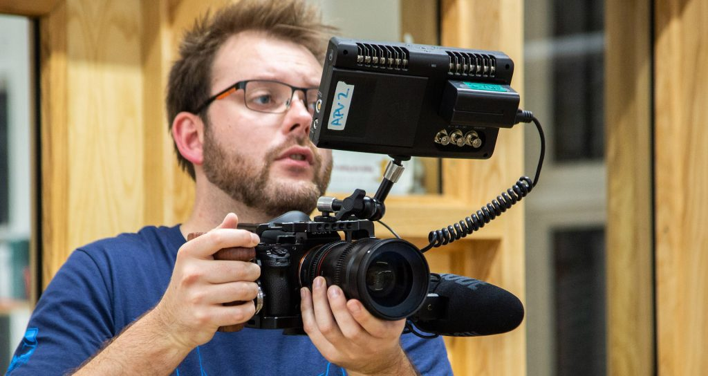 Adam Plowden on set with his mirrorless camera system